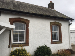 The outside of Kilfillan Cottage painted in white