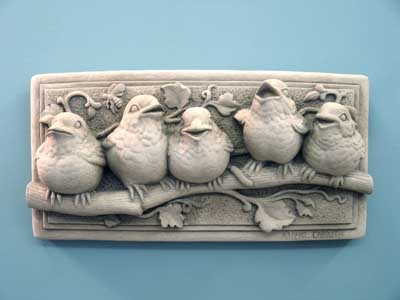 Plaque with three baby birds on a branch