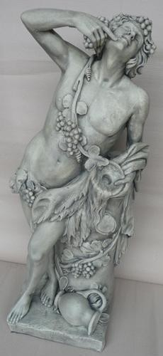 Naked male statue draped with vine leaves and grapes