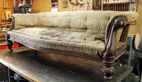 A settee in shoddy condition before restoration work by Steve Grimshaw