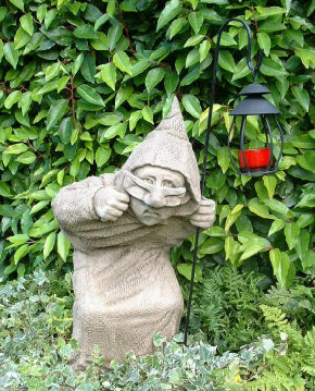 Hooded figure carrying lantern