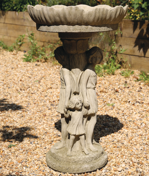 Flower top birdbath with fairy's holding hands around the base