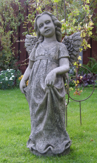 Female statue with wings and long dress