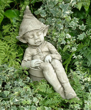 Elf sleeping in a flowerpot