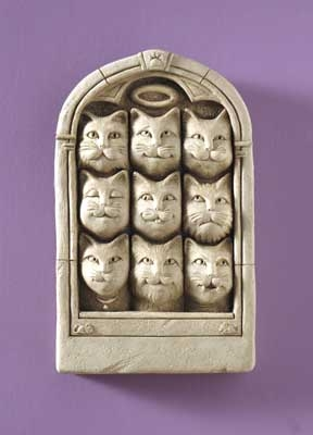 Arched window with 9 cat faces