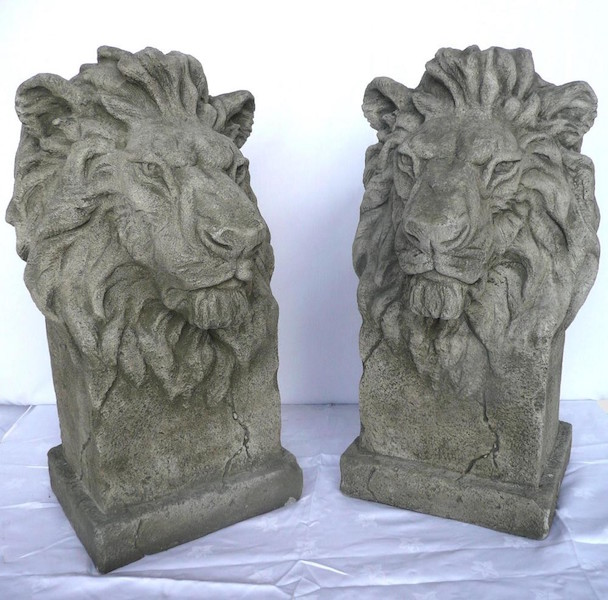 Pair of antique green stone lion heads