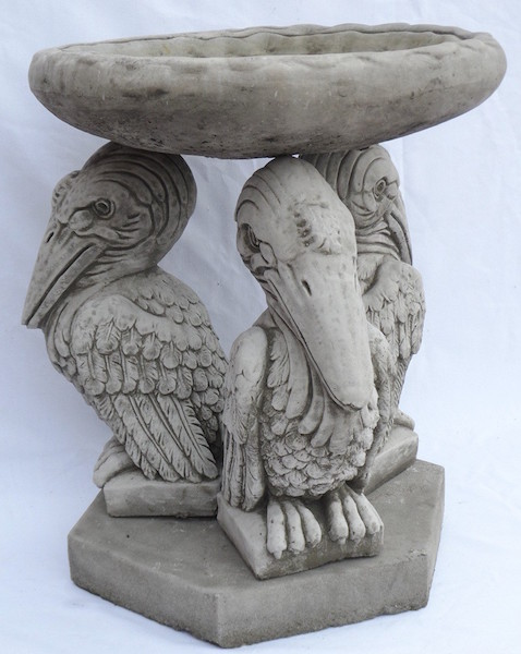 Bird bowl supported by three pelicans