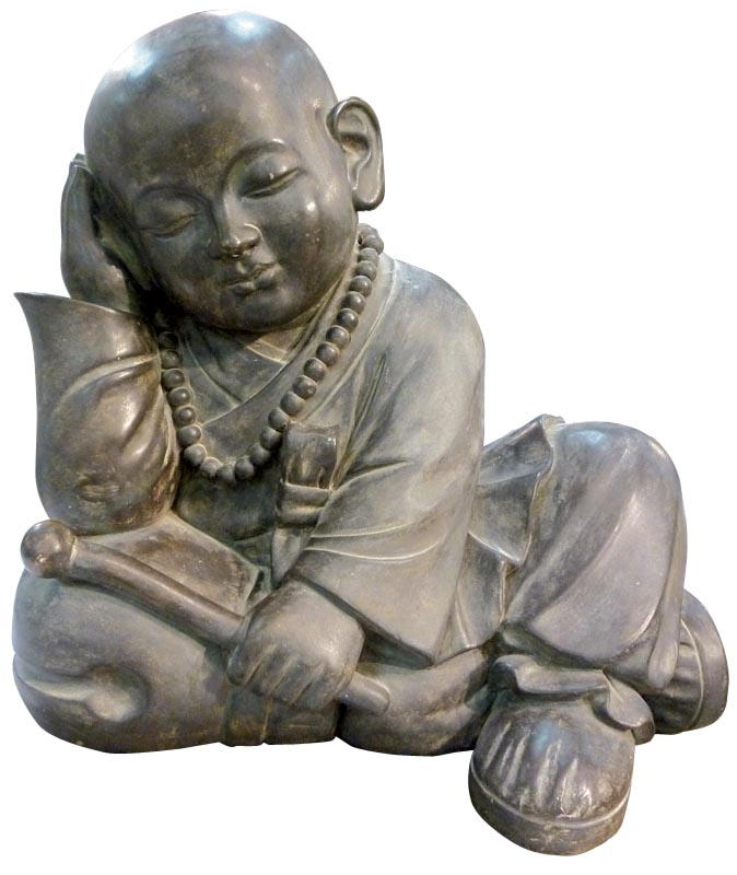 Buddha figure leaning on one elbow