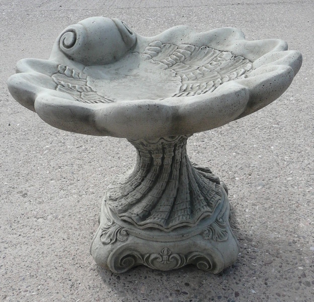 Scalloped shell bird bath