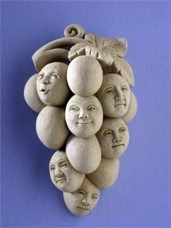 Bunch of grapes, some with human faces