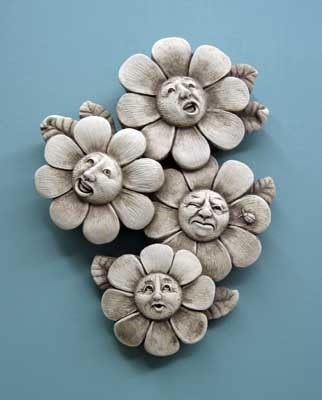 Four flowers with funny faces