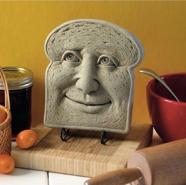 Slice of toast with a face recipe book stand