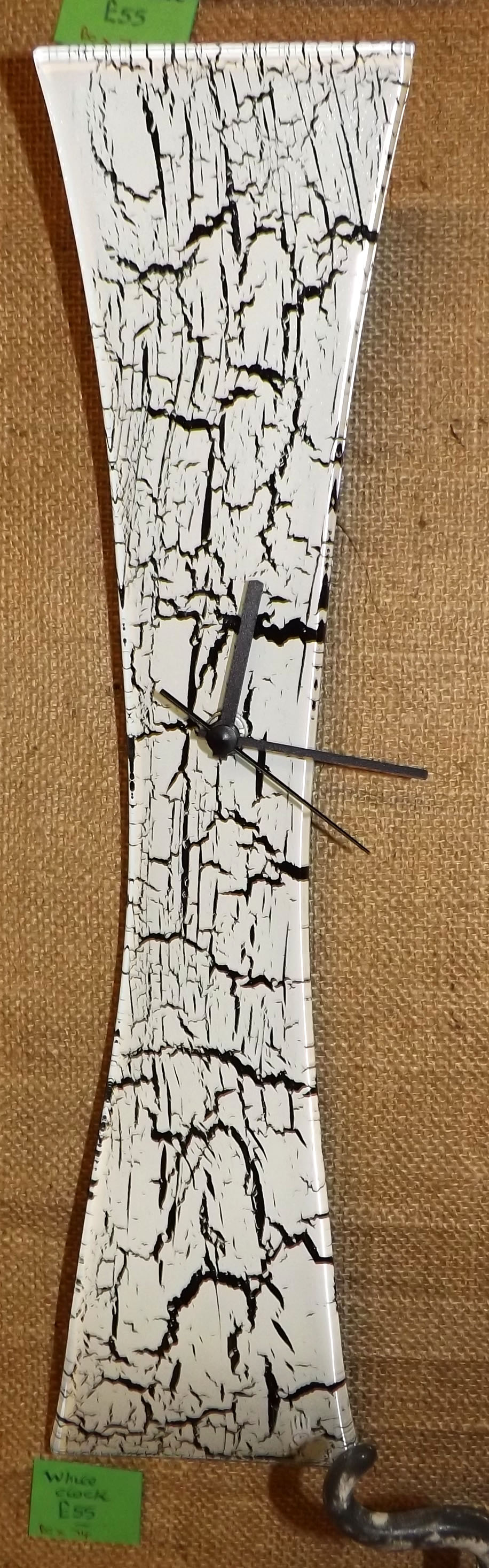 White clock with black crackles
