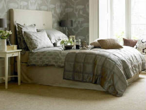 Bedroom with carpeting from Maskell Flooring