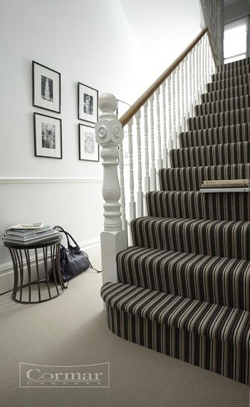 Hall and staircase covered with striped beige and brown carpet by Cormar