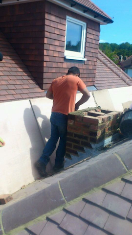 Repairing a chimney and retiling around a dormer window
