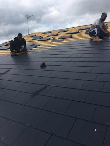 Two of The Roofing Company's professional team laying new tiles