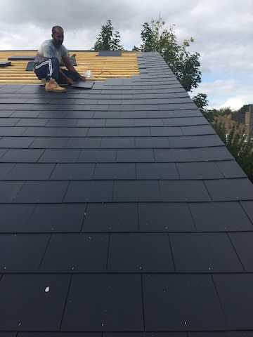 New tiles being positioned on a roof in Milton Keynes