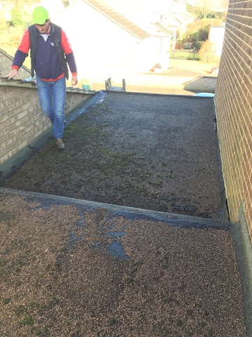 The Roofing Company inspection of a moss covered, patchy old flat roof on a domestic garage in Milton Keynes