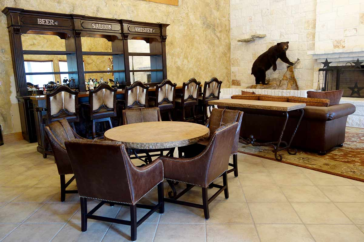 Amazing Hand Carved Bar with Axis Hide Barstools