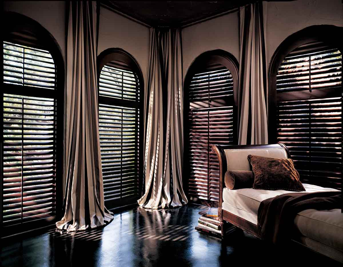 Classic Heritance hardwood shutters are plantation-style shutters crafted from real wood
