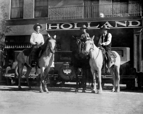 The historic Holland Hotel with guests on horseback