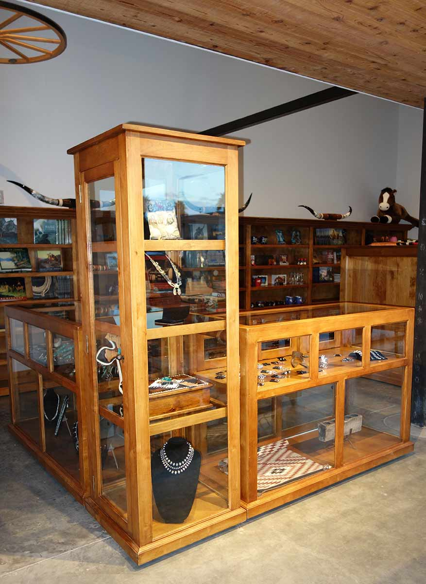 Large fitted Bookcase and Tall Glass Display Cabinet mounted on Industrial Casters