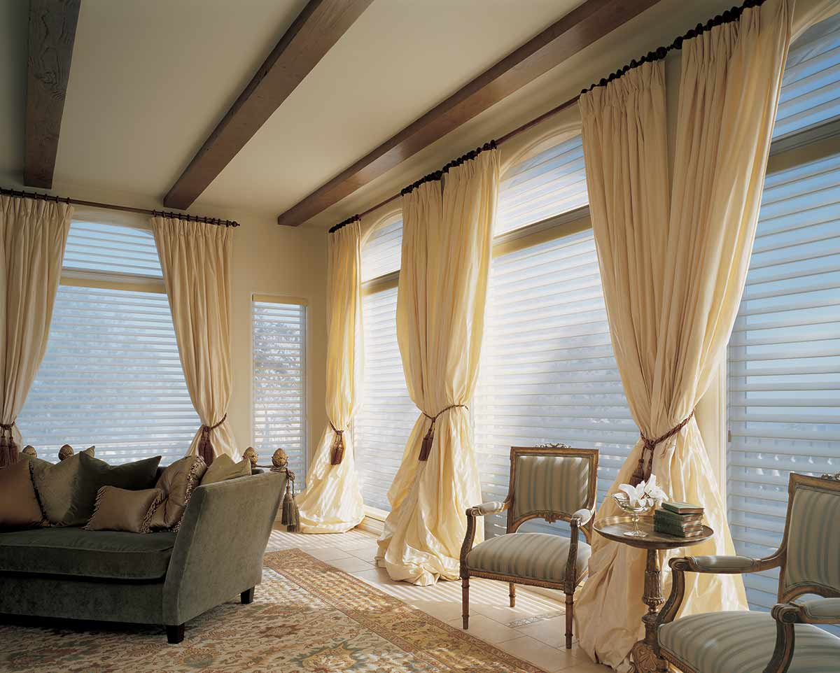 Silhouette shadings, soft adjustable fabric vanes that appear to be floating between two sheer fabric panels