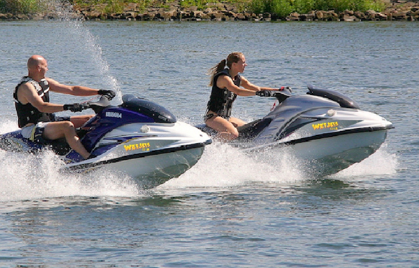 A man and a woman trying out the WetJets jet ski equipment on Auchenreoch Loch near Dumfries