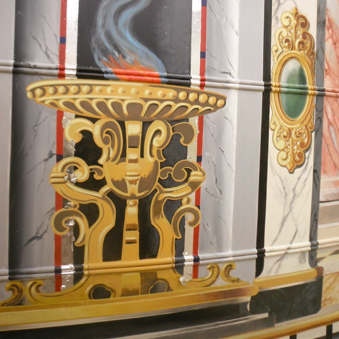 Sectioof painted rounding board for 1930's waltzer. A golden, very fancy urn with fire and painted grecian column