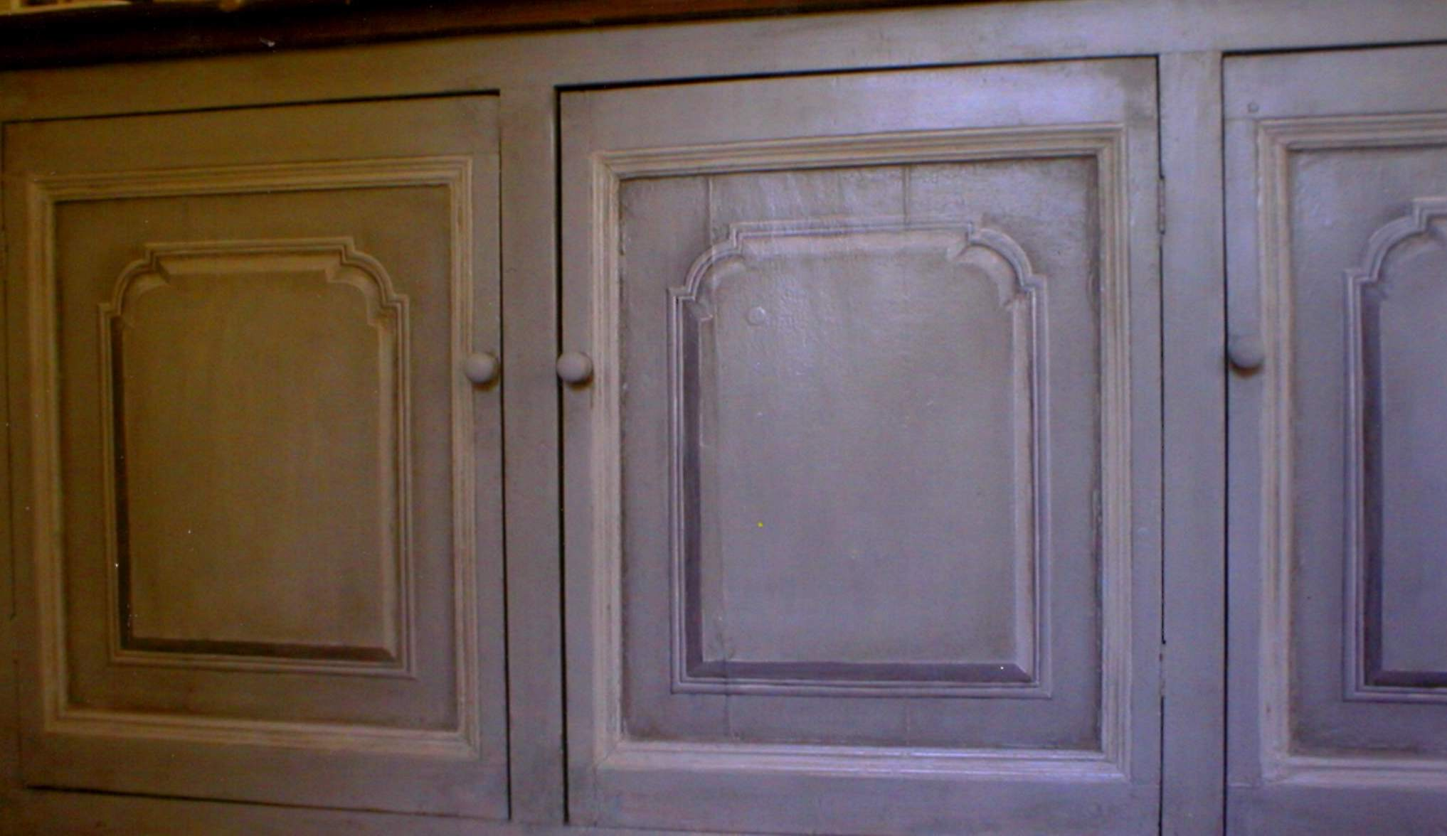 Painted french grey kitchen cupboard. Trompe l'oeil raised panels.