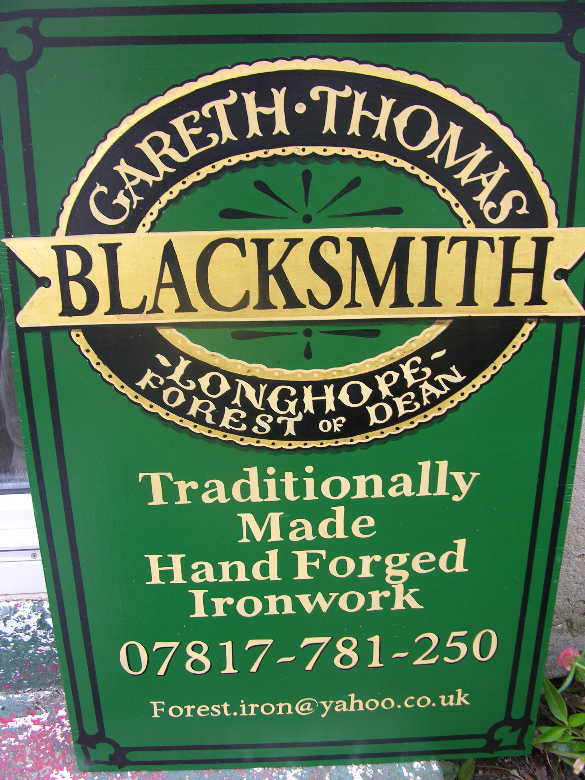 Sign board for Gareth THomas, Green and gold leaf with black lettering