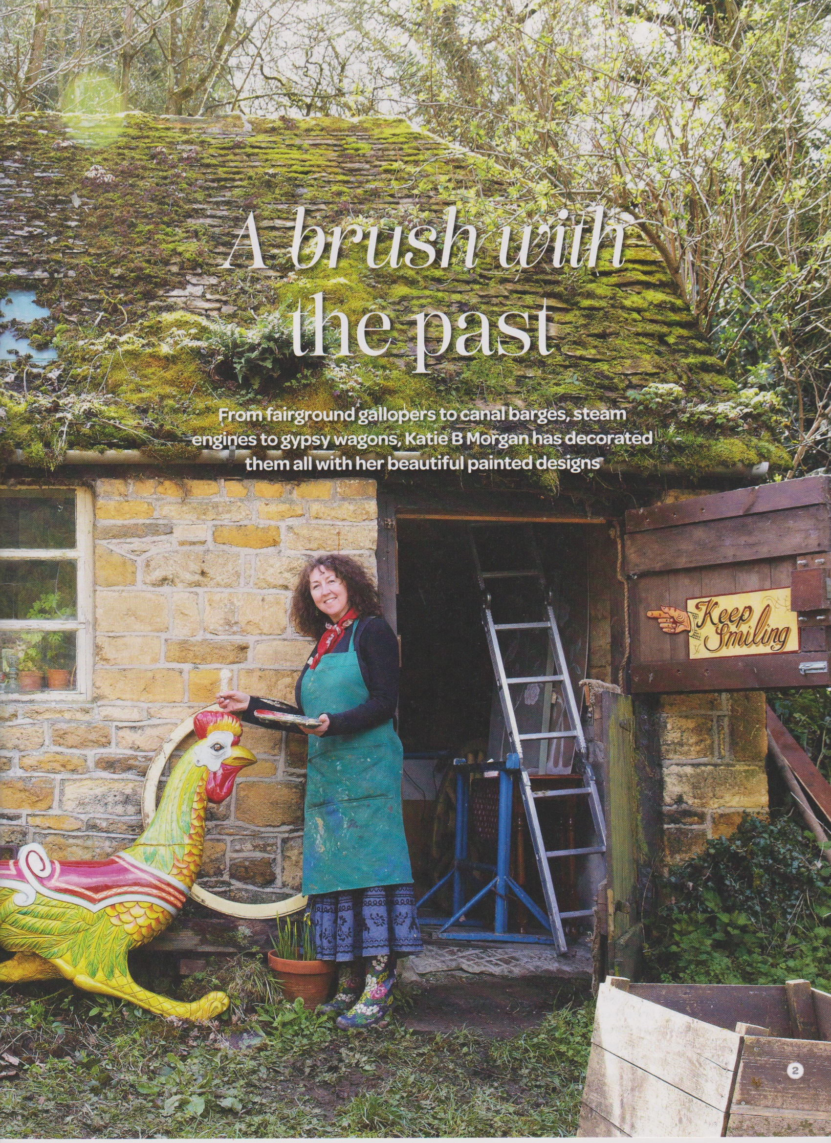 Article in Landlove Magazine, photo by Sussie Bell Katie stood outside her tiny stone workshop with fairground cockerel.