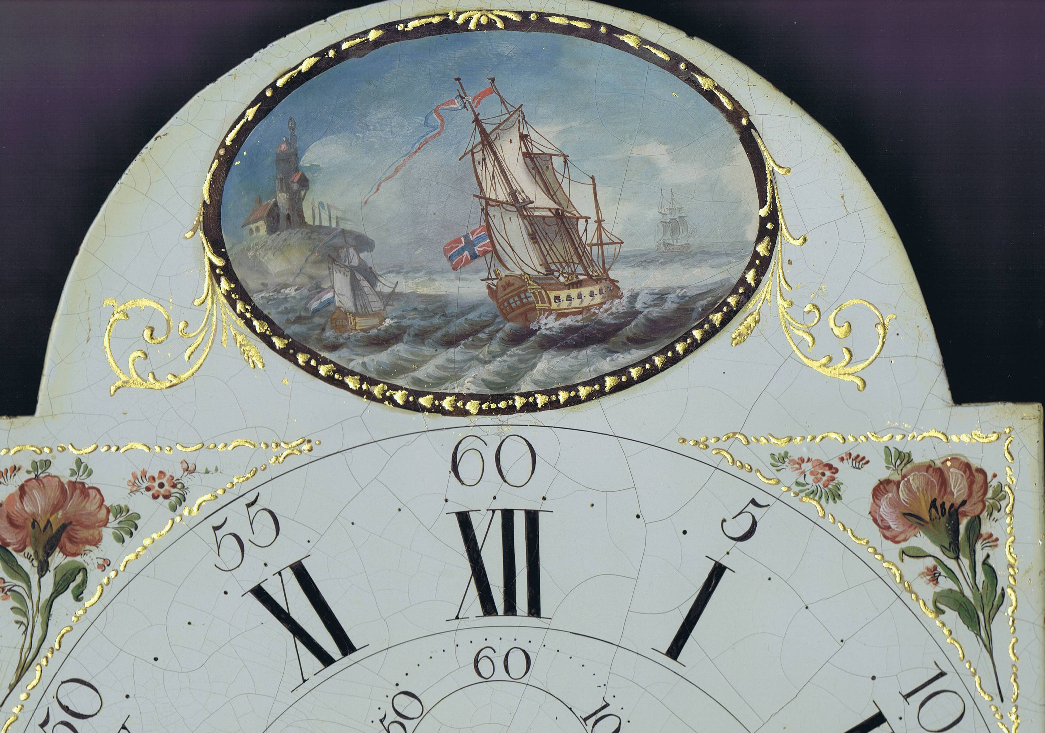 Top of a painted enamel clock dial.  Picture of old flagship on a stormy sea inside a black and gold oval frame.