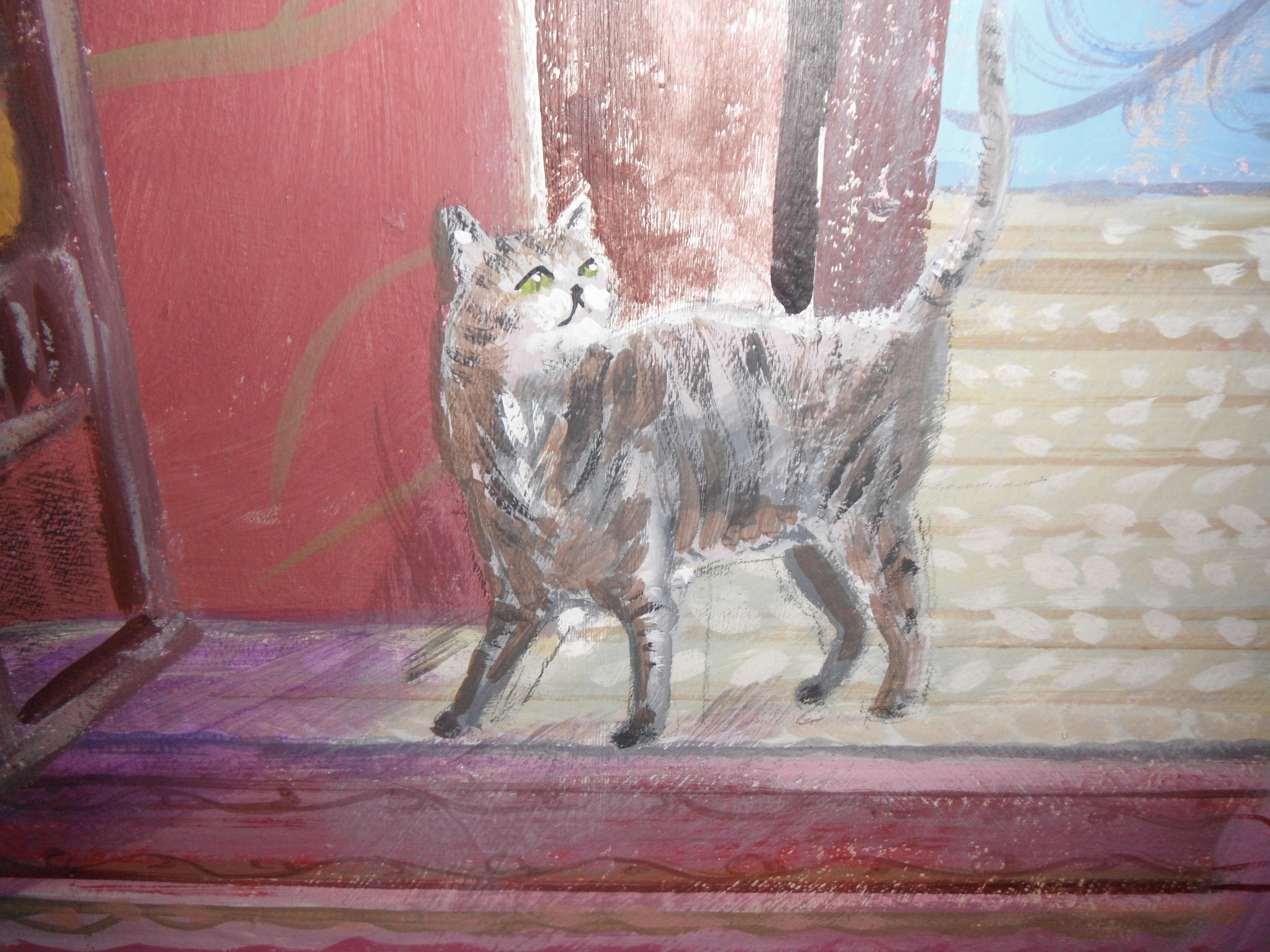 Close up of painted mural at Sudeley Castle. A tabby cat on a patterned carpet.