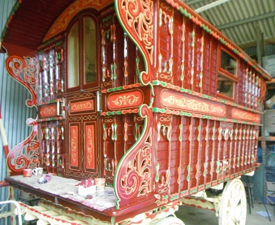 Maroand gold leaf reading style Gypsy wagon.