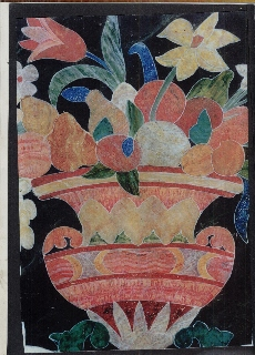 Panel painted to look like a vase of fruit and flowers made of shapes ofifferent marbles.