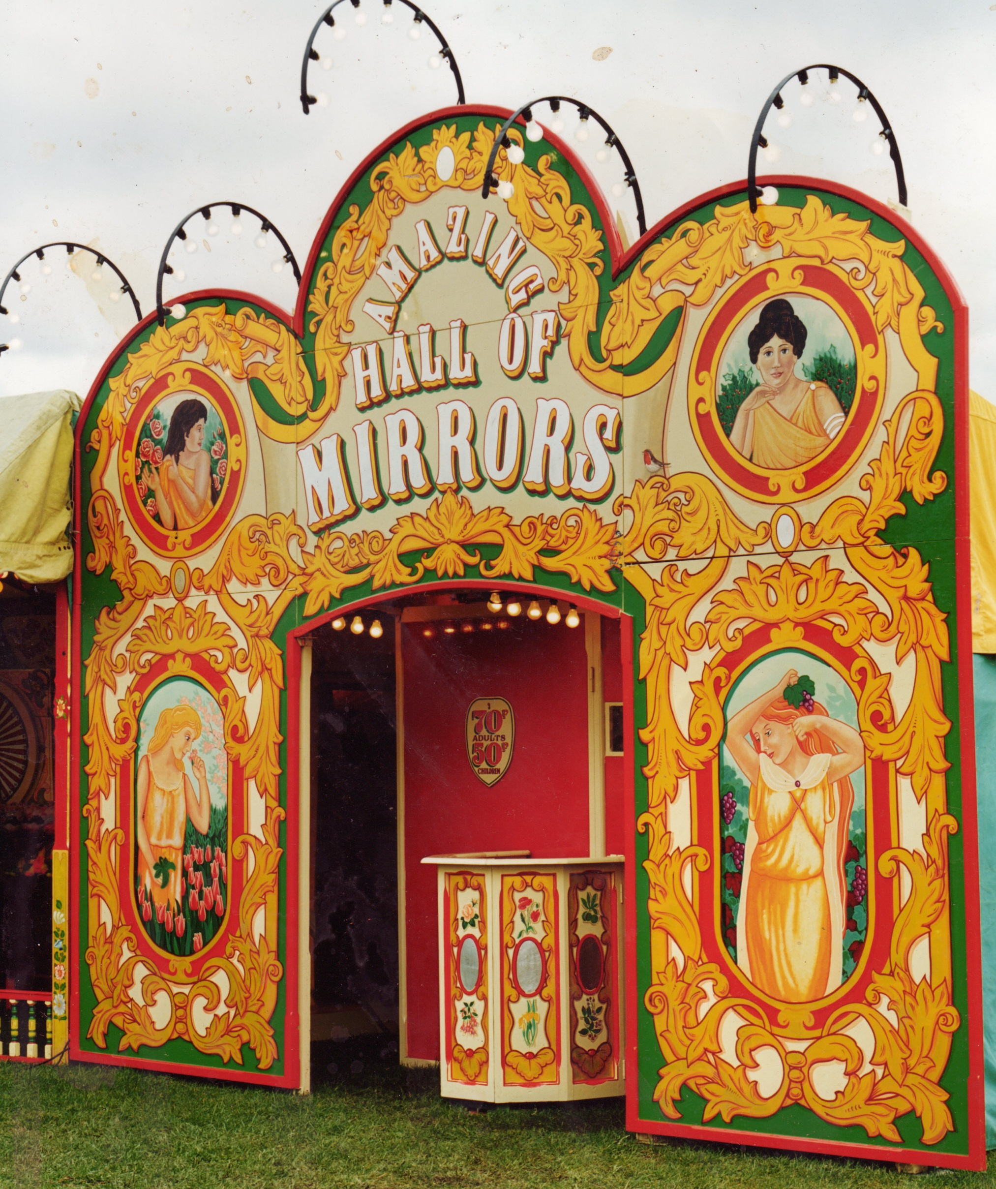 Hall of mirrors showfront, Gold scrolls with art nouveau painted ladies. Painted for carters steam fair in London.