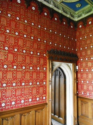 gold stencilled red walls in Sudeley Castle. Pattern made up of Portcullis and tudor rose