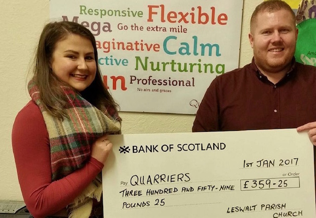 Two parishioners holding a cheque for Quarriers Children's Homes