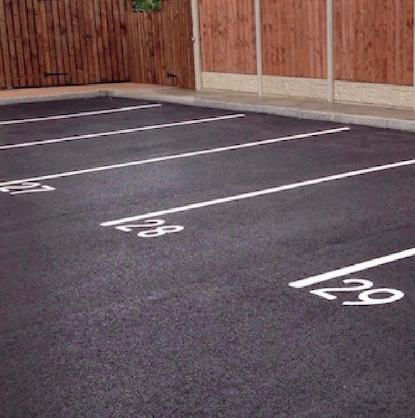 White line marking and number marking on a car park surface