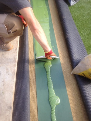 Preparing the adhesive for artificial grass