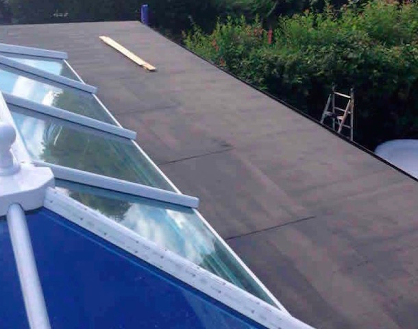 Covering a flat roof to make it weatherproof