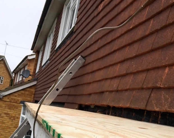 Replacing the roof tiles on a flat roof on a porch