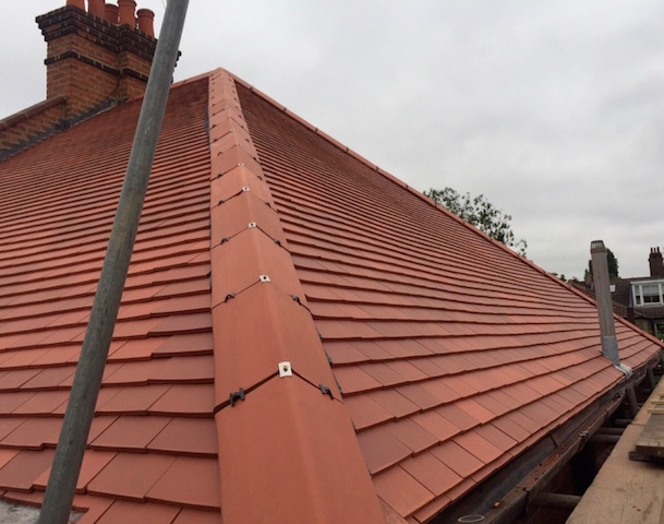 Ridge tiles and new roof by Seal It Roofing in Woking