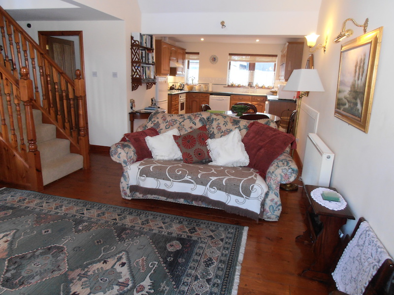 The open plan lounge and kitchen of The Dairy House holiday accommodation in Kirkcudbright