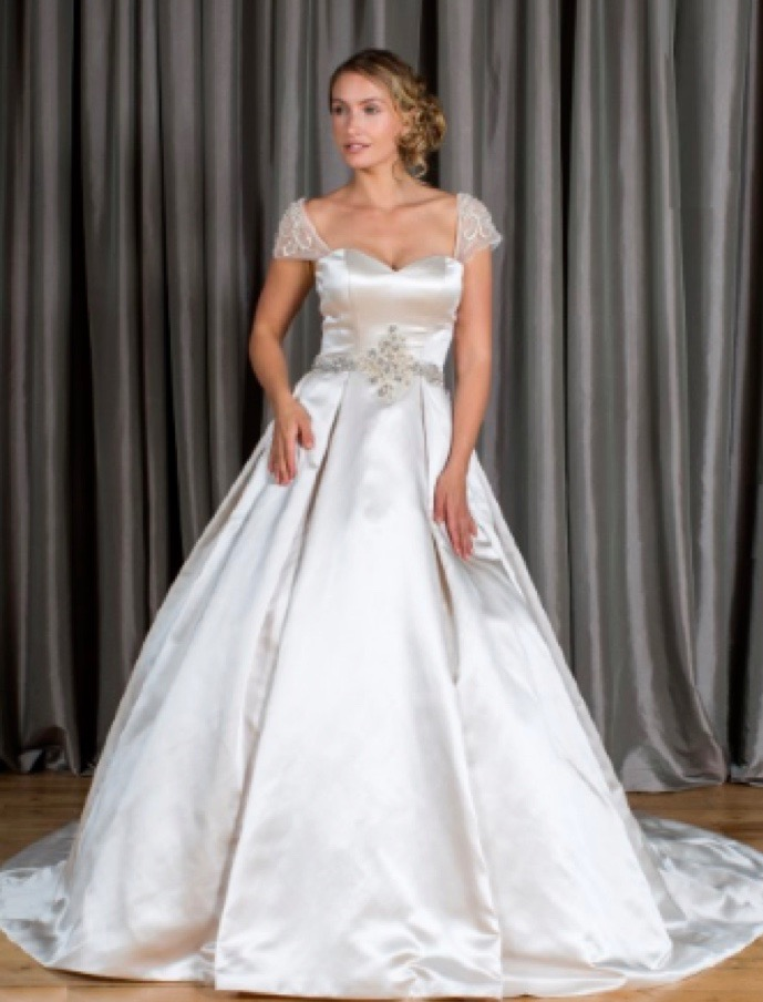 Satin bridal gown with lace cap sleeves and low sweetheart neckline, front view