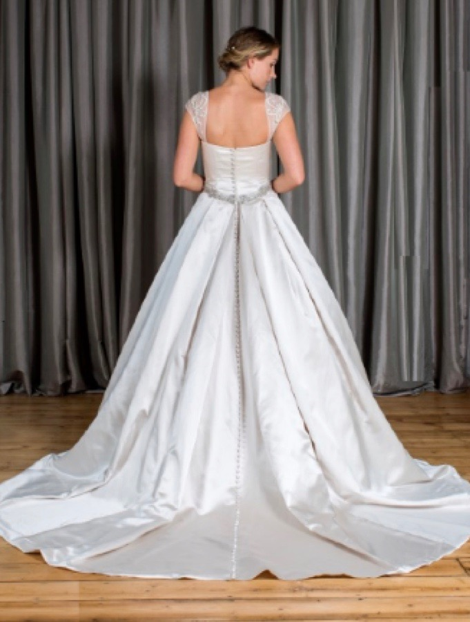 Satin bridal gown with lace cap sleeves and low sweetheart neckline, back view