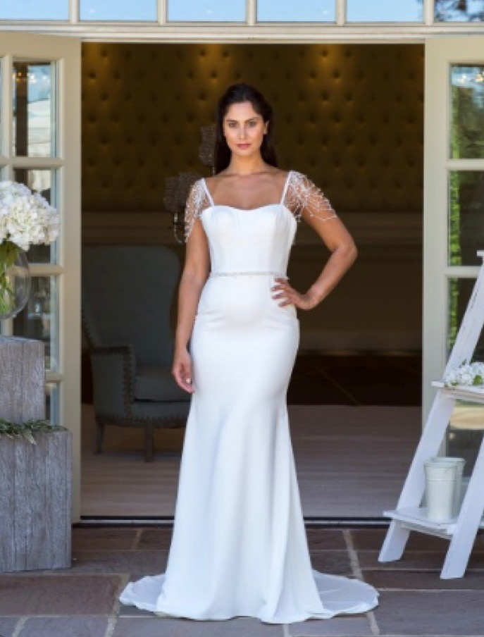Plunge back simple sheath wedding dress with beaded cap sleeves, back view