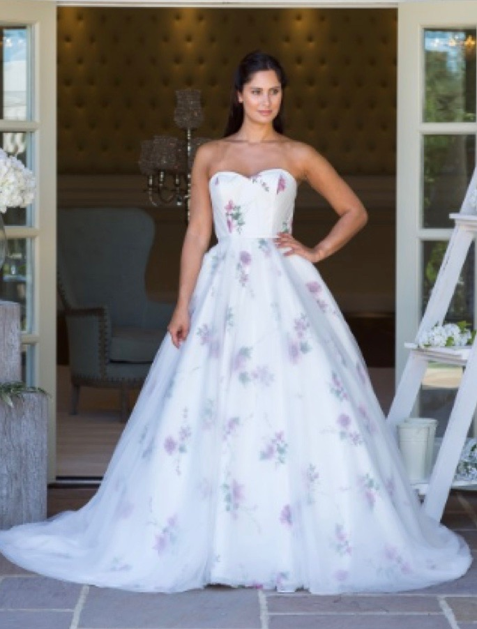 Sweetheart neckline white wedding dress with pink printed flowers in the Victoria Kay collection